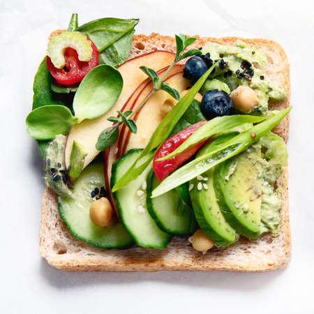 Vegan sandwich. Plant-based diet. Vegetarian healthy food concept. Clean eating. Top view.