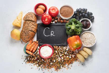 Natural sources of chromium.  Natural healthy products containing chromium:egg, tomato,cocoa, grape, bread, bean, shrimp, potato, yogurt. Top view