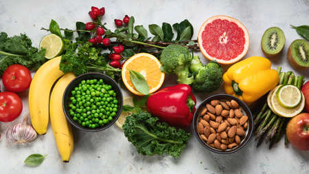 Foods high in vitamin C. Food rish in antioxidant, fiber, carbohydrates. Boost immune system and brain; balances cholesterol; promotes healthy heart.Top view with copy space