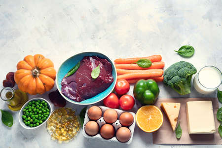 Foods high in vitamin A (Retinol). Protects eyes from blindness; supports bone health; supports a healthy immune system; Top view. Image with copy space