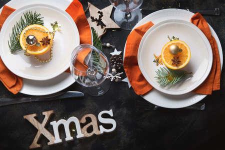 Christmas table setting. Holiday Decorations on black
