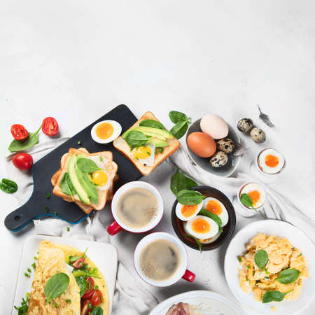 Tradidional egg dishes for breakfast. Essential Ways to Cook an Egg. Breakfast set with coffee cups. Top view, flat lay  with copy space