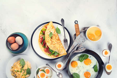 Cooked egg dishes for breakfast. Tradidional Ways to Cook an Egg. Top view, flat lay with copy space