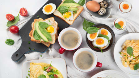 Tradidional egg dishes for breakfast. Essential Ways to Cook an Egg. Breakfast set with coffee cups. Top view, flat lay Banco de Imagens