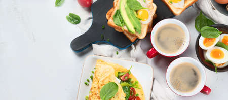 Tradidional egg dishes for breakfast. Essential Ways to Cook an Egg. Breakfast set with coffee cups. Top view, flat lay  with copy space. Panorama, banner