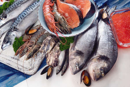 Fresh fish and seafood. Healthy diet eating concept.