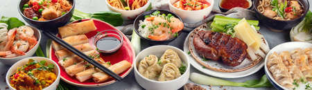 Assorted Chinese dishes on grey