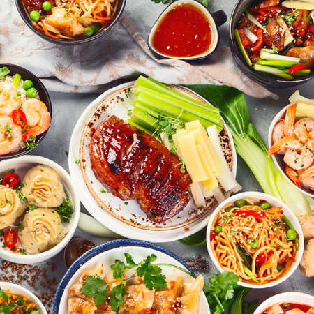 Assorted Chinese dishes on grey Archivio Fotografico