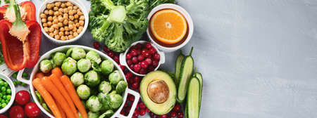 Vegan diet food. Selection of rich fiber sources vegan food.Foods high in plant based protein, vitamins, minerals, anthocyanins, antioxidants. Top view with copy space. Panorama, banner