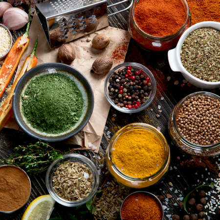 Various spices for cooking on rustic wooden background. Top view