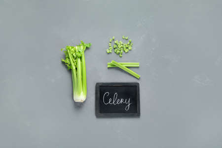 Fresh green organic celery. Celery chopped and celery stalks. Top view, chalkboard, sopy space 版權商用圖片