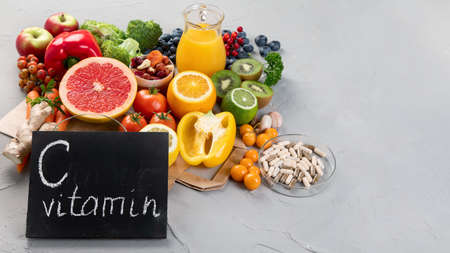Foods high in vitamin C. Food rich in antioxidant, fiber, carbohydrates. Boost immune system and brain; balances cholesterol; promotes healthy heart. Copy space, with chalkboard