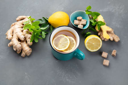 Ginger root with healthy tea with and lemon. Top view