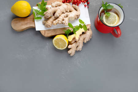 Ginger root with healthy tea with and lemon. Top view, copy space