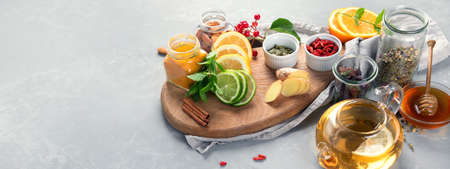 Alternative medicine, natural homemade remedy for cold and flu on gray background. Immunity boosting. Panorama, banner