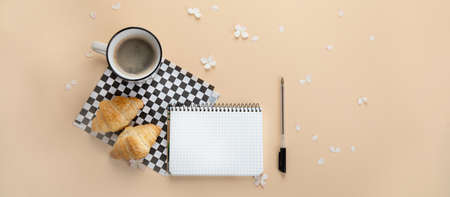 Morning cup of coffee, empty notebook, snacks and hydrangea flowers. Top view, flat lay. Panorama, banner