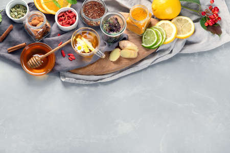 Alternative medicine, natural homemade remedy for cold and flu on gray background. Immunity boosting. Top view, copy space
