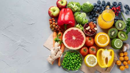 Foods high in vitamin C. Food rich in antioxidant, fiber, carbohydrates. Boost immune system and brain; balances cholesterol; promotes healthy heart. Top view, copy space