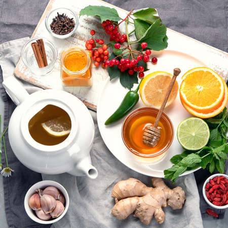 Alternative medicine, natural homemade remedy for cold and flu on gray background. Immunity boosting. Top view 版權商用圖片