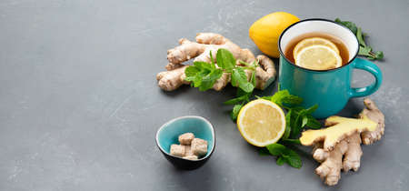 Ginger root with healthy tea with and lemon. Panorama, banner copy space