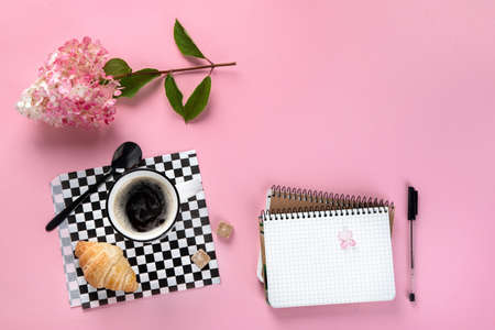 Morning cup of coffee, empty notebook, snacks and hydrangea flowers. Top view, flat lay with copyspace
