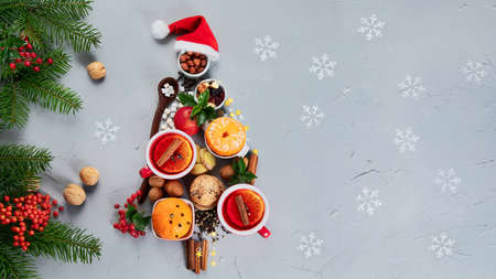 Christmas Tree made of holiday food on concrete background. Top view, flat lay with copy space. Christmas concept. New Year Holidays background.