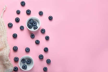 Fresh blueberries on pink background. Seasonal berry. Top view, copyspace 版權商用圖片