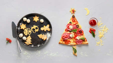 Piece of pizza set like christmas tree. Christmas and New year concept. Top view