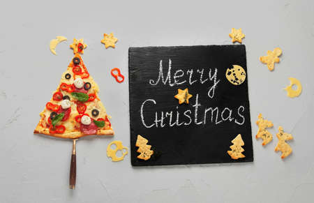 Piece of pizza set like christmas tree. Christmas and New year concept. Top view, copy space