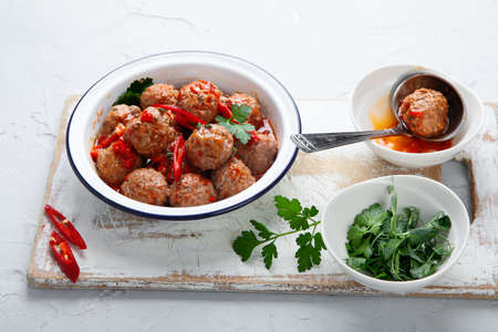 Homemade meatballs with tomato sauce. Homemade food concept. Top view, copy space