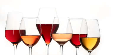 Red, rose and white wine in glasses on white background. Panorama, banner with copy space