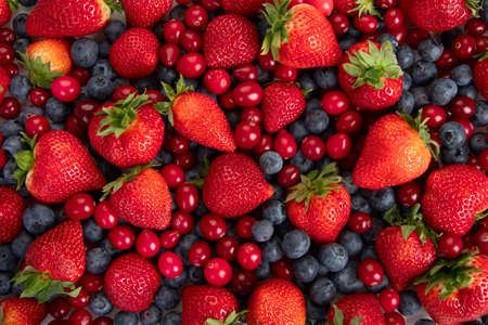 Various fresh forest berries on white background. Organic food concept. Top view Standard-Bild