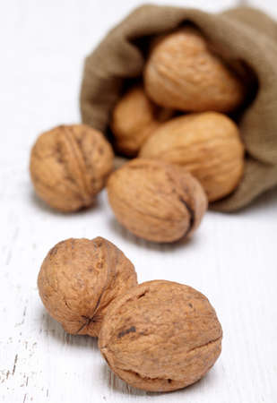 Walnuts on white wooden background photo