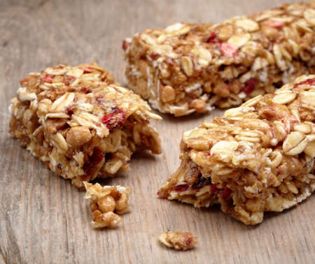 energy bar: Granola bar on wooden background