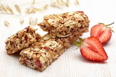 Granola bar and strawberries photo