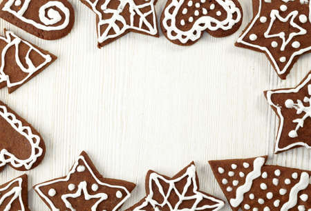 Christmas frame of gingerbread cookies photo