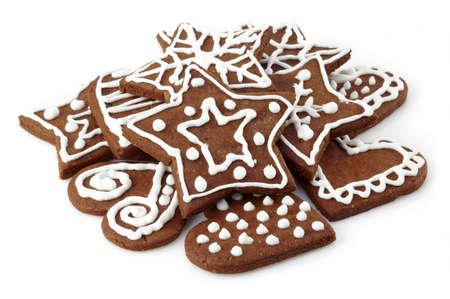 gingerbread heart: Heap of gingerbread cookies on white background