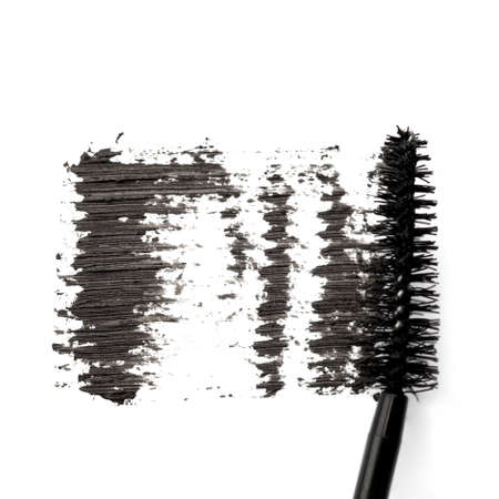 Stroke of black mascara on white background photo