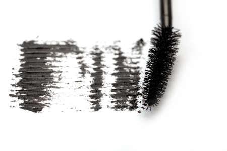 Stroke of black mascara on white background photo