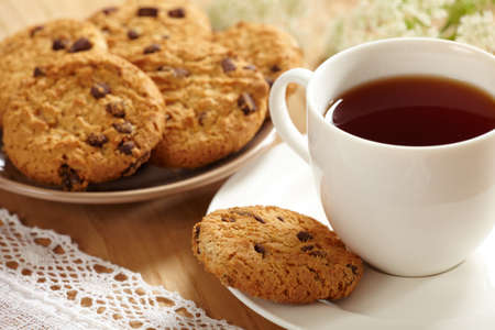 Cup of tea and cookies photo