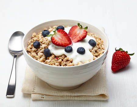 crunchy: Bowl of healthy muesli with yogurt and fresh berries
