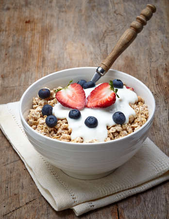 bran: Bowl of healthy muesli with yogurt and fresh berries