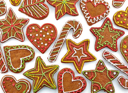 Colorful gingerbread cookies on white background photo