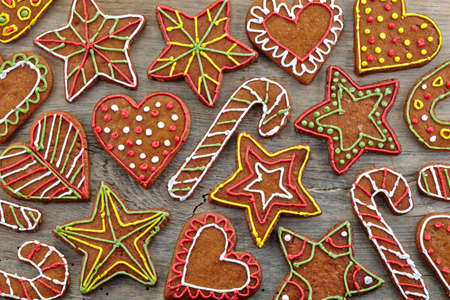 Colorful gingerbread cookies on wooden background photo