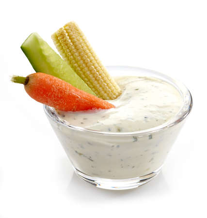 Fresh vegetables and garlic dip on white background Stock Photo