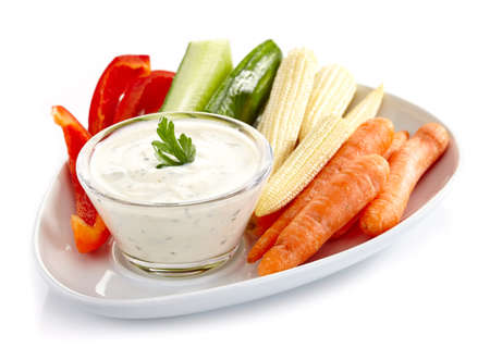 Plate of fresh vegetables and garlic dip