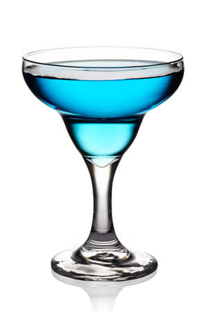Glass of blue cocktail on white background photo