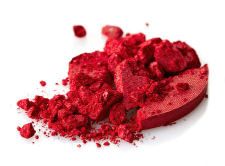 Red crushed eye shadows on white background