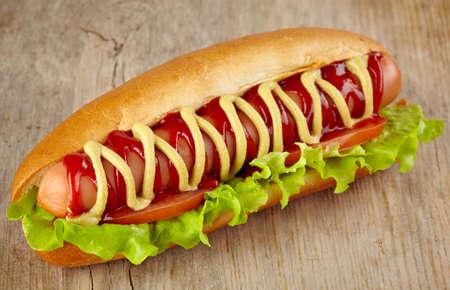 Hot dog on wooden background Stock Photo