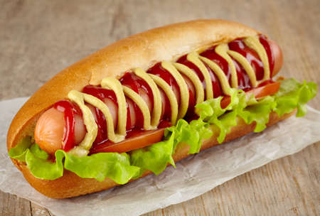 Hot dog on wooden background photo